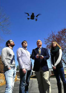 Dr. Payne (3rd from left) demonstrates a UNG quadcopter drone with student researchers.
